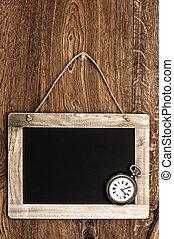 vintage blackboard hanging on wooden wall