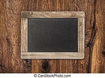 vintage blackboard on wooden wall