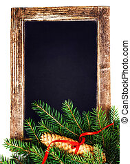 Vintage Blackboard with Christmas Tree Branch isolated on white
