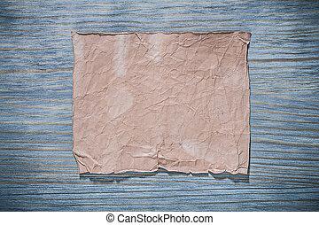 Vintage blank sheet of paper on wooden board