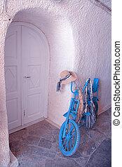 vintage blue bike with white door, Greece
