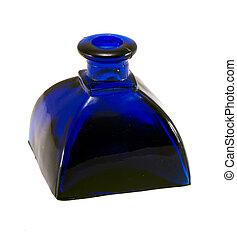 vintage blue glass bottle isolated on white