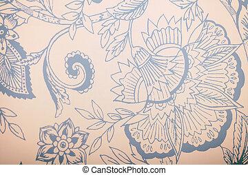 Vintage blue wallpaper with floral pattern.