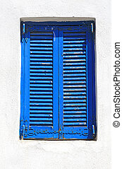 Vintage blue window with shutter (Greece)