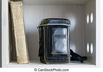 vintage book and camera - leather case of TLR photo camera ...