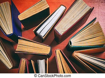 Vintage books on wooden background - top view