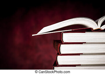 Vintage Books over Red Grunge Background