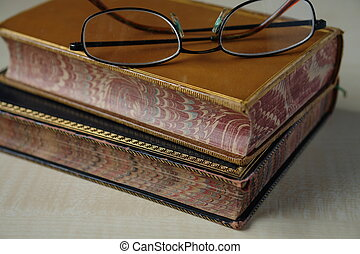 Two 19th century books with nicely ornamented edges and sides bought in a second-hand bookshop in England