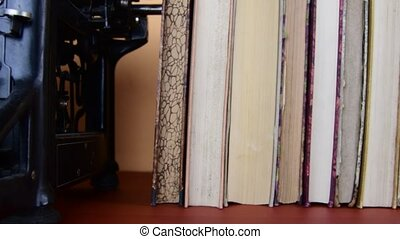 Vintage books. View of row of old books and vintage typewriter