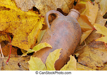 Vintage Bottle and Fallen Maple Leaves