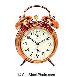 Vintage bronze alarm clock isolated on white.