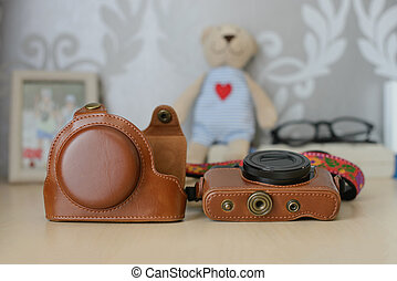 Vintage brown leather camera case - This photo tell about...