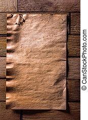 vintage brown paper on old wooden boards
