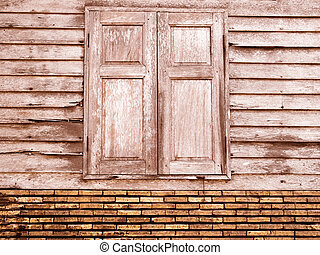 Vintage brown unique ancient wooden window and old crack brick wall retro style in rural for background.