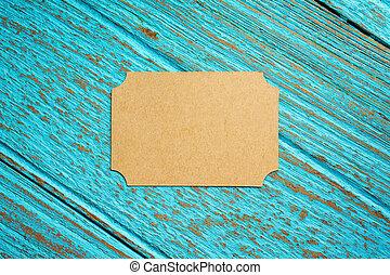 Vintage business card on wood background