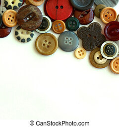 Vintage Button Collection Bordering White Background