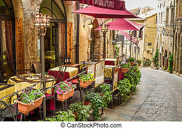 Vintage cafe on the corner of the old city in Italy
