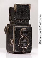 Vintage camera - A vintage twin lens reflex camera against a...