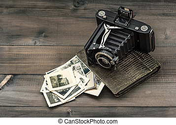 vintage camera and album with old photos
