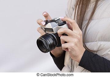 Vintage camera in hands