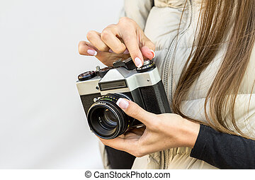 vintage camera in the hands of girl
