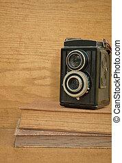 Vintage camera on book