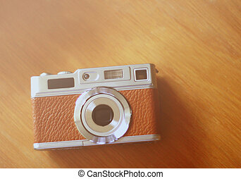 Vintage camera style on wooden background with retro filter effe