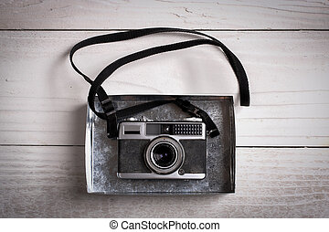 Vintage Camera - Vintage photo camera on a wooden table