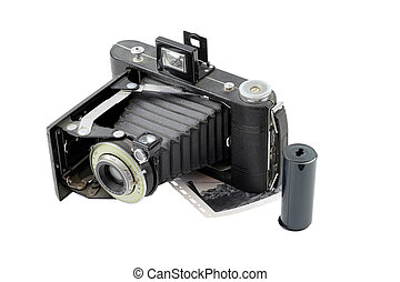 vintage camera with film on white