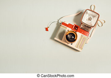 Vintage camera with flash top view