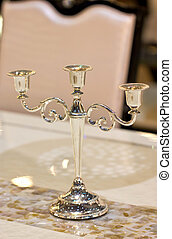 Vintage candlestick on table.