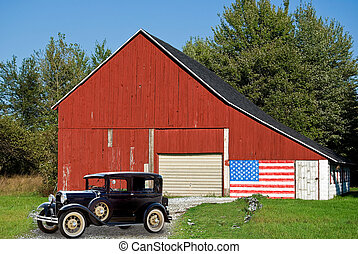 vintage car by red barn with flag - Red barn with old car.