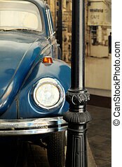 Vintage car - Detail of vintage car parked by a street lamp