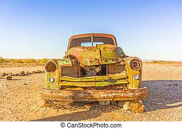 Vintage car in Namibian desert - Old rusty car in desert in...