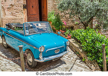 Vintage car on a beautiful street in Italy