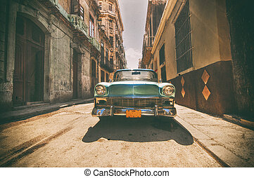Vintage car parked in Havana street - Retro style image with...