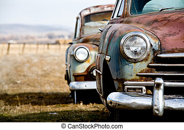 vintage car - two abandoned vintage cars in rural wyoming