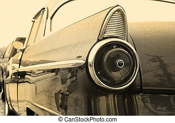 Tail lamp of vintage car in sepia color