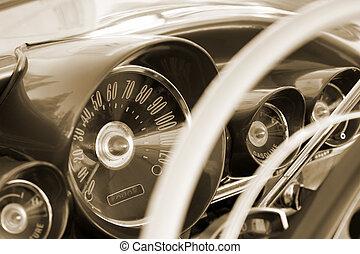 Vintage Car - Vintage car control panel. Sepia toned.