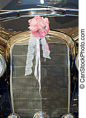Vintage car with wedding bouquet