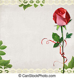 Vintage card from old paper and rose on the  abstract background