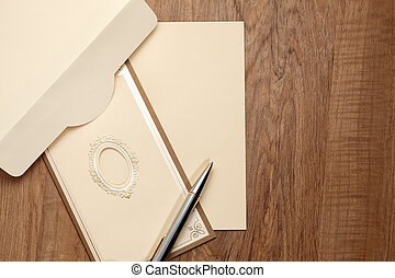 Vintage card with blank paper on wood table