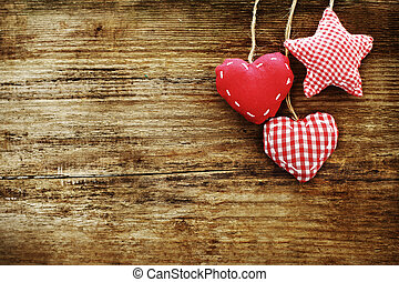 Vintage card with red hearts on wooden background
