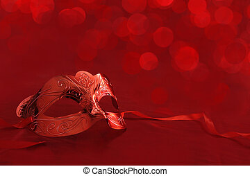 Vintage carnival mask in front of red lights background