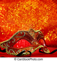 Vintage carnival mask in glittering background