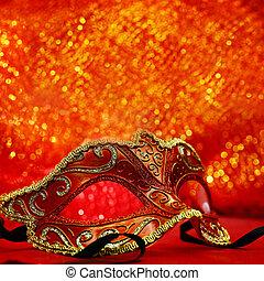 Vintage carnival mask in glittering background