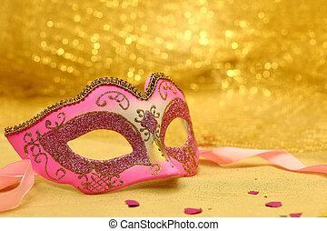 Vintage carnival mask in golden background
