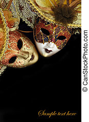 Vintage carnival masks on black background with copy-space
