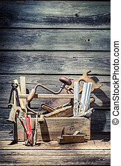 Vintage carpenter tools in wooden toolbox
