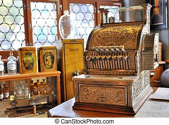 Vintage cash register in an old pharmacy
